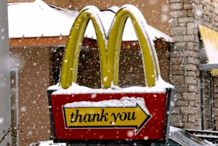 Snow Falls Over McDonalds