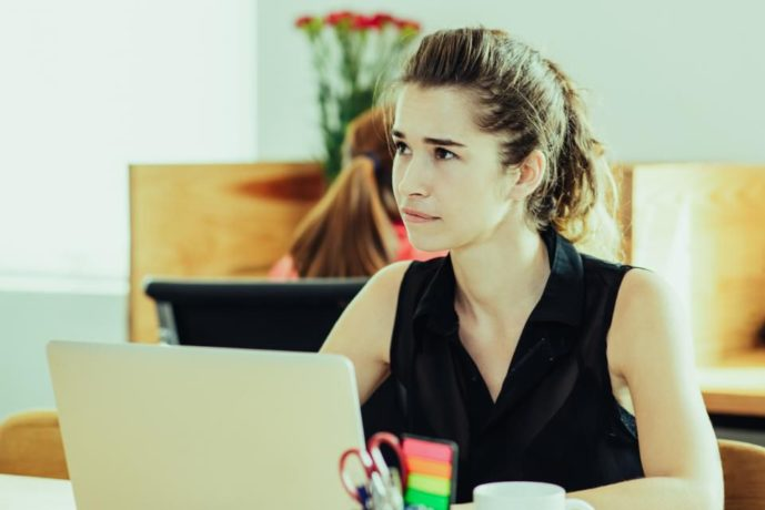 Woman-sitting-at-a-desk
