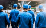 Workers walking through factory as a group